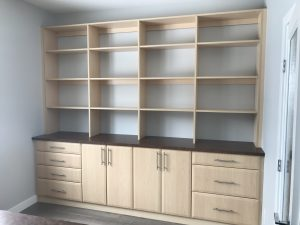 book shelves with lower cabinetry