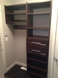 mudroom or entry storage with hooks and drawers