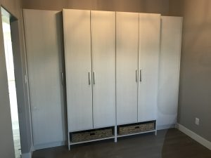 grey wardrobe with hanging and flat storage