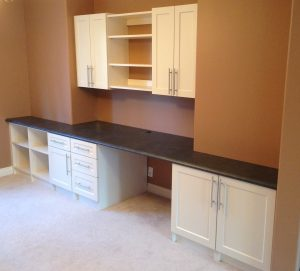 long wall desk with upper cabinet storage