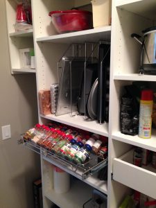 pantry storage with slide out spice rack
