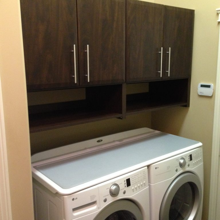laundry room above machine cabinetry